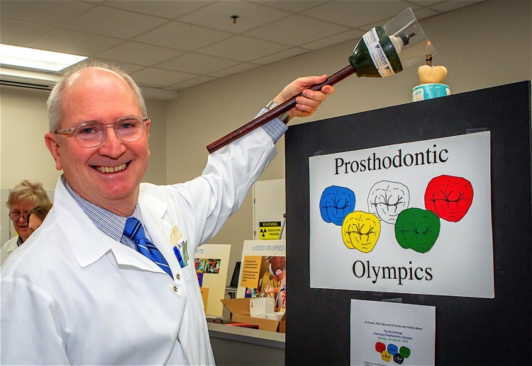 Dr. Loney lights the Olympic flame