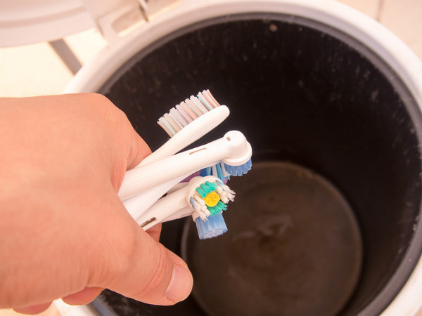 Tossing Toothbrushes Into The Trash!